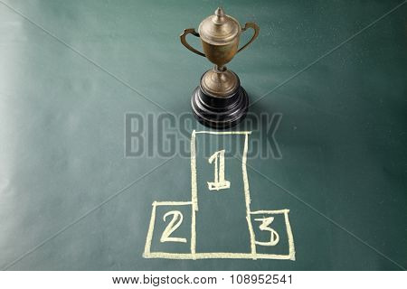 trophy on the blackboard with drawing podium 1,2,3