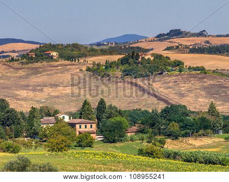 Tuscany Landscape Dotted With Farms And Villas