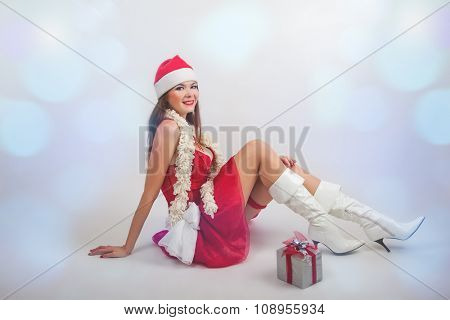 portrait of a beautiful Santa girl in studio
