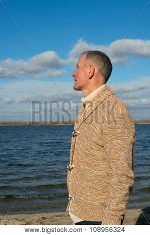 Joyful Dreaming Man, Wearing Casually, Walking Along The Coast , Looking Into The Distance