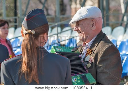 Elderly veteran of World War II with accordion