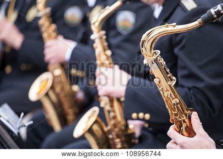 Musicians Are Playing On Saxophone