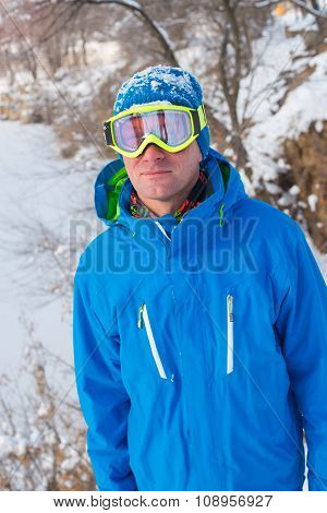 Snowboarder Resting At A Ski Resort