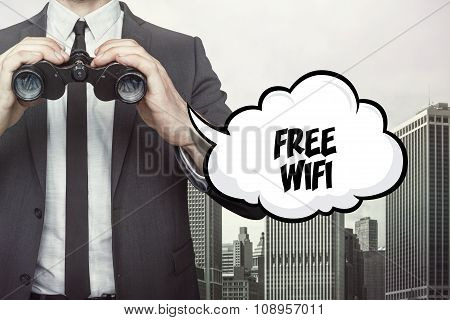 Free wifi text on speech bubble with businessman holding binoculars
