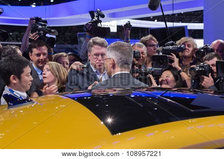 Michael Horn, President And Chief Executive Officer Of Volkswagen Group Of America, Center With Back