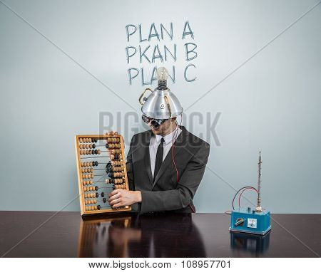 Plan A concept with vintage businessman and calculator