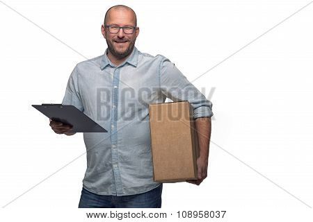 Smiling Male Courier Delivering A Parcel