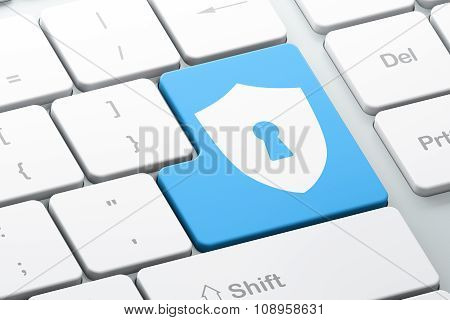 Privacy concept: Shield With Keyhole on computer keyboard background