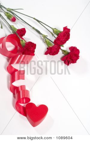 Carnation And Red Plastic Heart