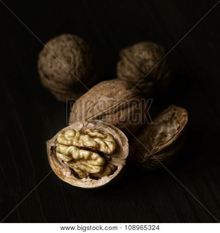 Walnuts On Rustic Old Wooden Table