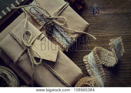 Presents in rustic wrap, wood background