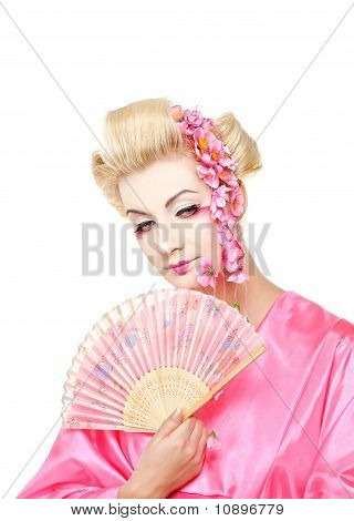 Beautiful geisha with a fan. Isolated on white background
