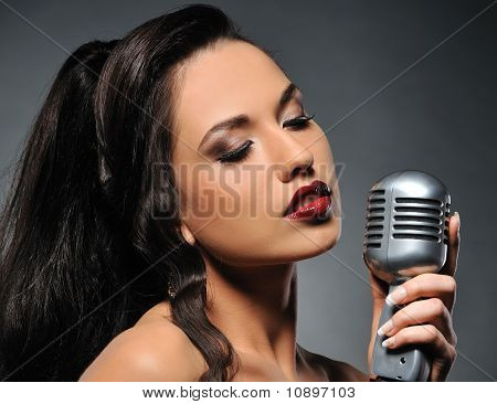 Beautiful brunette woman singing