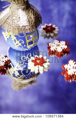 Red With White Snowflakes And Christmas Hut.