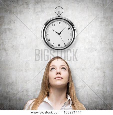 A Portrait Of A Beautiful Lady Who Is Looking At The Hovering Pocket Watch. A Concept Of A Value Of