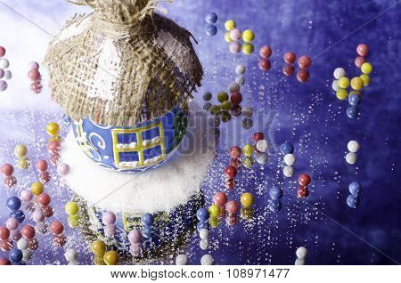 Christmas Hut In White Snowdrift And Small Candies.