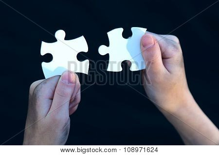 Young Homeless Boy Holding Puzzles