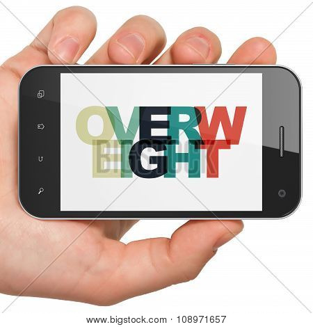 Health concept: Hand Holding Smartphone with Overweight on  display