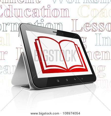 Education concept: Tablet Computer with Book on display