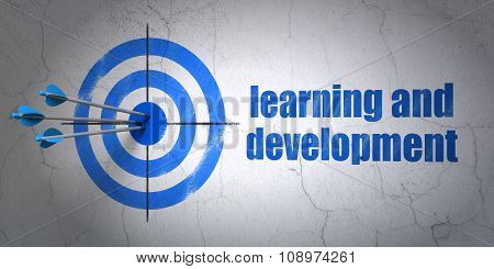 Studying concept: target and Learning And Development on wall background