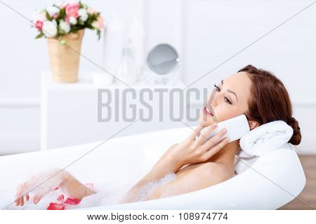 Charming girl taking a bath
