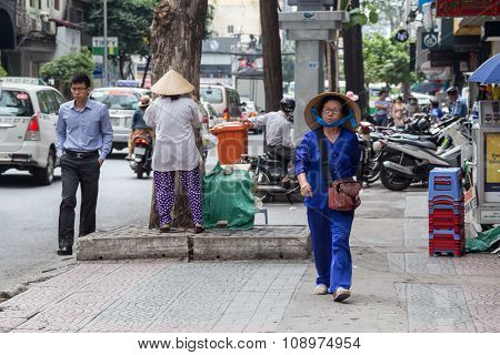 Ho Chi Minh, Vietnam - Circa August 2015: Pedestrian Vietnamese Woman Walks On The Street Of Ho Chi