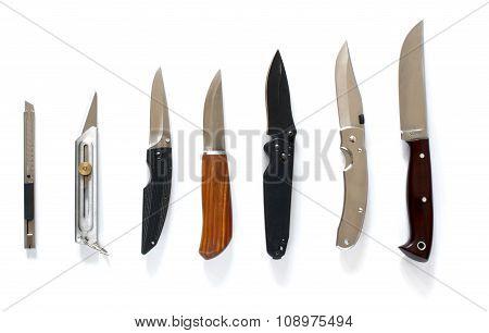 Knife Set In Line Over White
