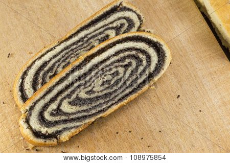 Sliced Poppy Seed Strudel Sliced On The Wooden Table