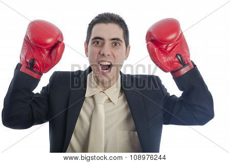 Man In Suit With Red Boxing Gloves With His Arms Up Shouting.