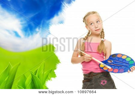 Beautiful little girl painting a nature landscape