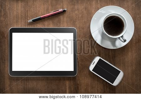 A Tablet, Coffee, A Smartphone And A Pencil On Living-room Table