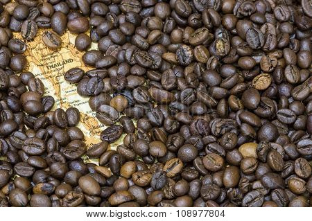 Map Of Thailand Under A Background Of Coffee Beans
