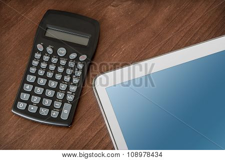 Business Work With Tablet & Calculator