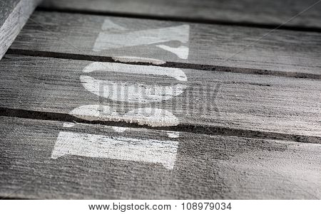 Side Macro Of Wood Panels With A Box Logo