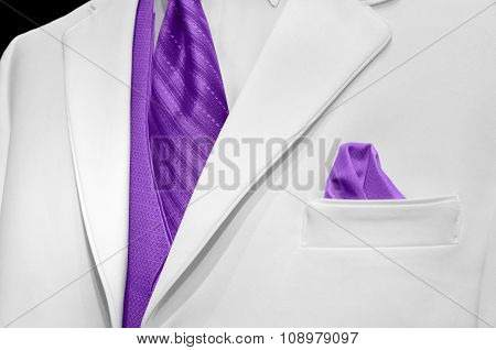 white tuxedo with purple tie