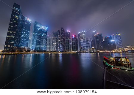 Singapore, Singapore - Circa September 2015: Singapore City Lights Are Reflected In The Marina Bay A