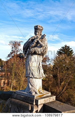 Statue Of A Bishop With A Cross With Jesus Christ