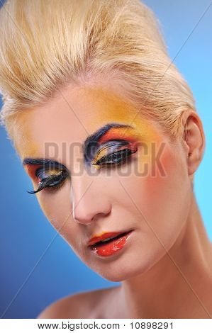 Beautiful young woman with a make-up close-up portrait