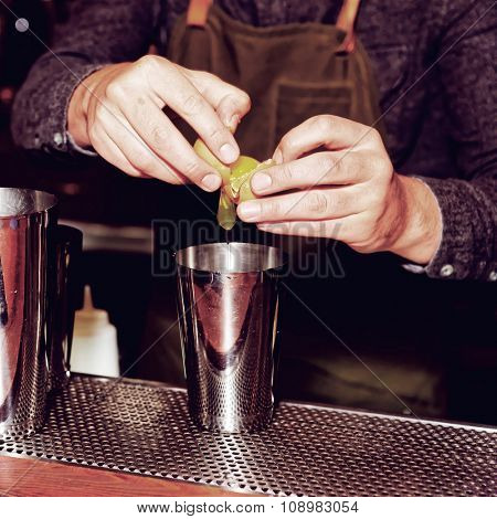 Bartender is adding egg white to shaker to make a flip cocktail