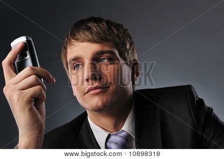 Young businessman holding a mobile phone