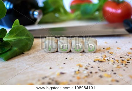 Knife, Salad, Cubes And Spices On A Chopping Board
