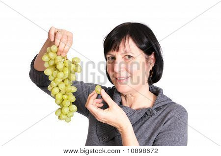 Retired Woman Eating Grapes