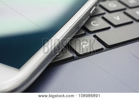 A White Mobile On A Keyboard With Search Button #2