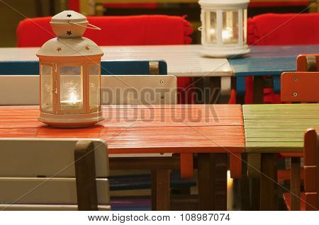 On Colorful Tables Standing Lighting Candle Lanterns