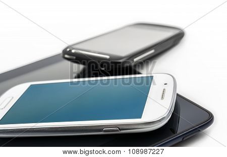 White Smartphone On Tablet & Black Mobile Leaning On Tablet #1