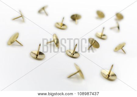 A Small Collection Of Thumbtacks In A White Box