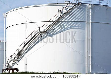 White Tanks In Tank Farm With Staircase