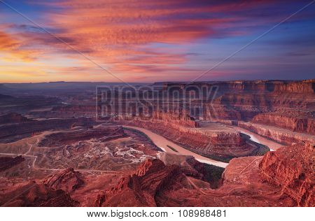 Colorful sunrise at Dead Horse Point, Colorado river, Utah, USA