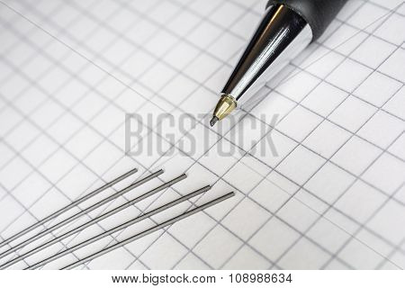 Macro Of A Mechanical Pencil With 5 Leads On Squared Paper 1