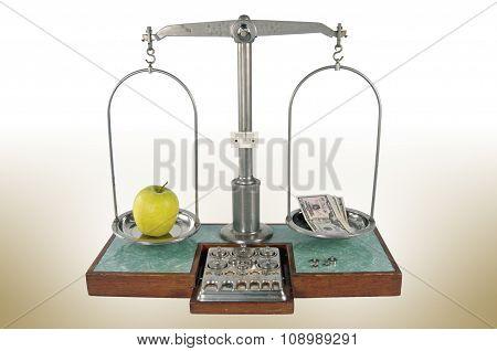 Apple and money balanced scale